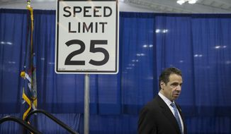 New York Gov. Andrew Cuomo leaves the stage after speaking to the media during a news conference and bill signing that authorizes New York City to lower their speed limit, Saturday, Aug. 9, 2014, in New York. (AP Photo/John Minchillo)