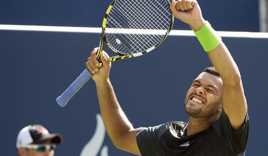 Jo-Wilfried Tsonga of France reacts after defeating Grigor Dimitrov of Bulgaria at the Rogers Cup tennis tournament, Saturday, Aug. 9, 2014 in Toronto. (AP Photo/The Canadian Press, Nathan Denette)