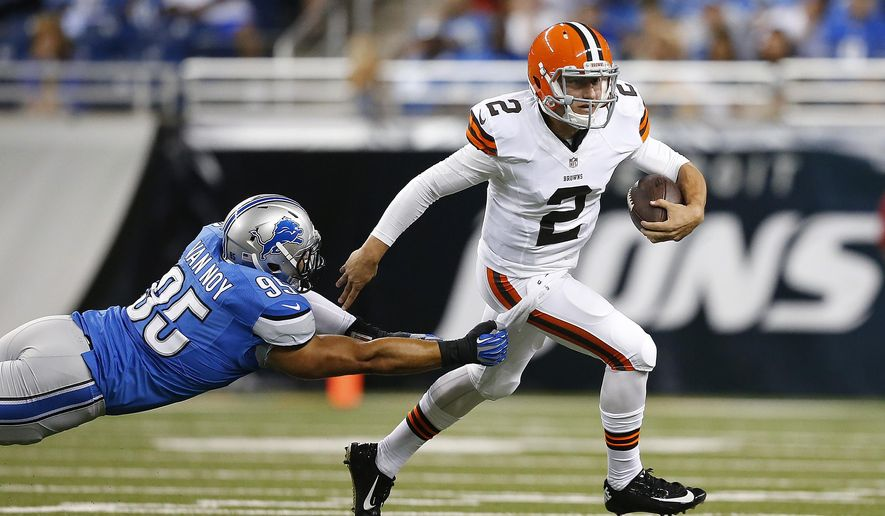 Cleveland Browns quarterback Johnny Manziel (2) breaks the tackle of Detroit Lions outside linebacker Kyle Van Noy (95) in the first half of a preseason NFL football game at Ford Field in Detroit, Saturday, Aug. 9, 2014.  (AP Photo/Rick Osentoski)