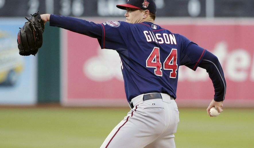 Minnesota Twins starting pitcher Kyle Gibson (44) throws to the Oakland Athletics during the first inning of a baseball game on Friday, Aug. 8, 2014, in Oakland, Calif. (AP Photo/Marcio Jose Sanchez)