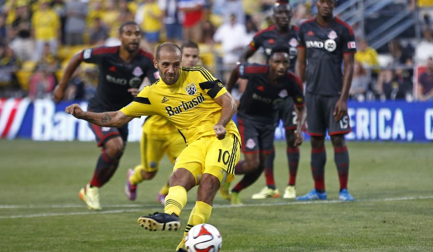 Columbus Crew forward Federico Higuain (10) scores on a penalty kick in the first half of an MLS soccer game against Toronto FC on Saturday, Aug. 9, 2014, in Columbus, Ohio. (AP Photo/The Columbus Dispatch, Eamon Queeney)