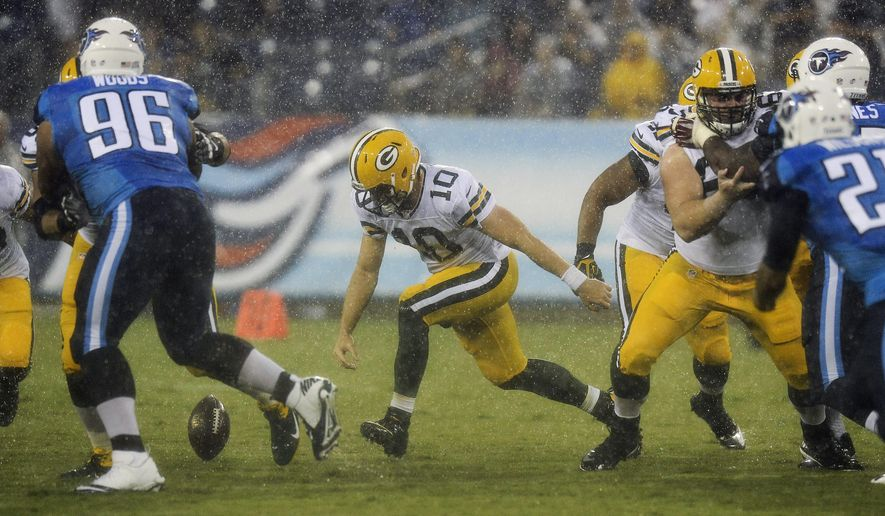 Green Bay Packers quarterback Matt Flynn (10) chases down his own fumble in the second quarter of a preseason NFL football game against the Tennessee Titans, Saturday, Aug. 9, 2014, in Nashville, Tenn. (AP Photo/Mark Zaleski)