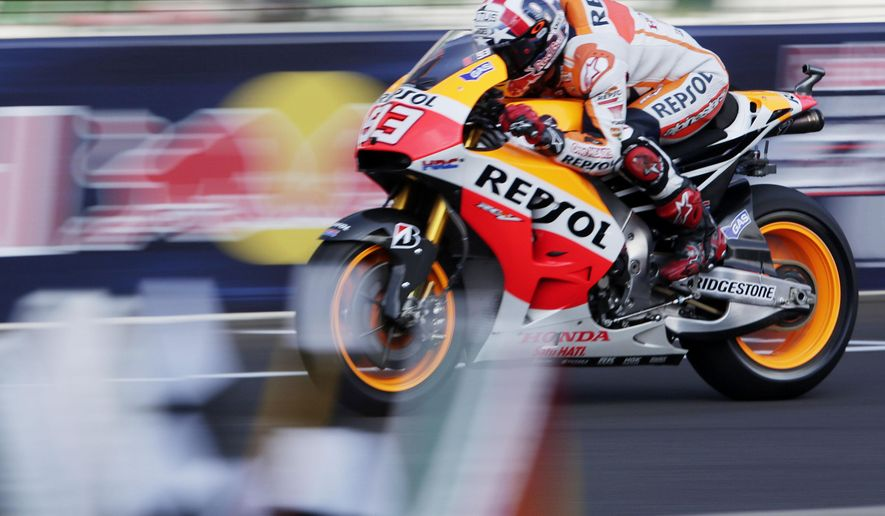 Marc Marquez, of Spain, rides down the front straight during the third practice for the Indianapolis Moto GP motorcycle race at the Indianapolis Motor Speedway in Indianapolis, Saturday, Aug. 9, 2014. (AP Photo/AJ Mast)