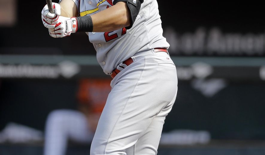 St. Louis Cardinals' Jhonny Peralta doubles in the first inning of an interleague baseball game against the Baltimore Orioles, Saturday, Aug. 9, 2014, in Baltimore. Matt Carpenter scored on the play. (AP Photo/Patrick Semansky)