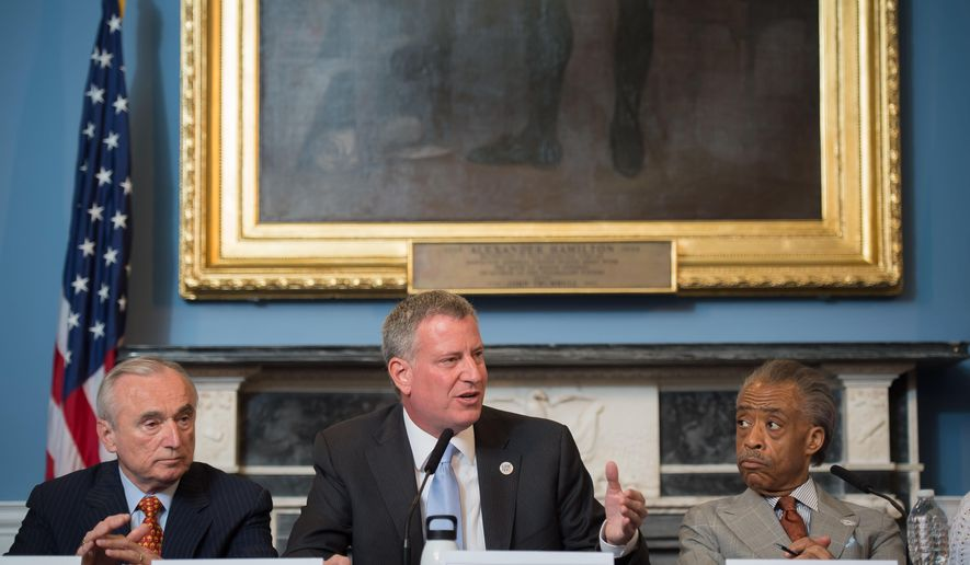 """FILE- In this July 31, 2014 file photo provided by the New York City Mayoral Photography Office, New York Mayor Bill de Blasio, center, is seated between New York City Police Commissioner William Bratton, left, and the Rev. Al Sharpton, during a round table discussion convened to ease tensions over the July 17, police involved death of Eric Garner. In an interview with The Associated Press, Police Commissioner Bill Bratton said he wanted to counter """"some of the misimpressions and some of the momentum that's been gained by self-serving interests"""" in the wake of the videotaped death last month of Garner. (AP Photo/New York City Mayoral Photography Office, Bob Bennett, File)"""