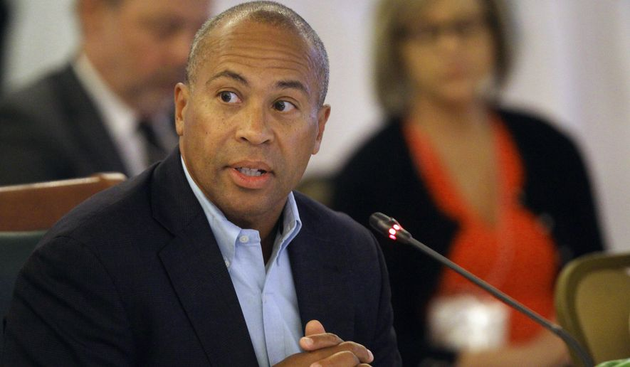 FILE - In this July 14, 2014 file photo, Gov. Deval Patrick, D-Ma., speaks at the New England Governors and eastern Canadian Premiers 38th annual conference  in Bretton Woods, N.H.  Patrick has a handful of bills on his desk awaiting his signature, including a proposed overhaul of the state's gun laws. The bill would give Massachusetts police chiefs the right to go to court to try to deny firearms identification cards needed to buy rifles or shotguns to individuals they feel are unsuitable. (AP Photo/Jim Cole)