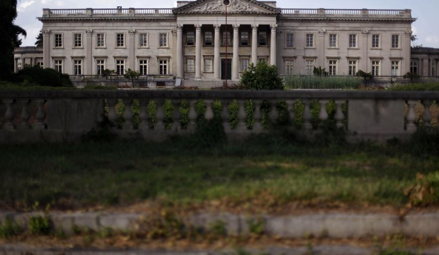 FILE - This July 19, 2010 photo shows Lynnewood Hall, in Elkins Park, Pa., just outside of Philadelphia. The dilapidated 110-room, 70,000-square-foot estate is on the market again, but experts say the $20 million price tag would be in addition to tens of millions more in repairs. The 34-acre estate in the Elkins Park neighborhood has been in decline since the original heirs sold it in 1944.  Mary DeNadai, an architect who specializes in historic restoration, said it would take about $50 million to restore the home to its former glory, but time is running out. (AP Photo/Matt Rourke)