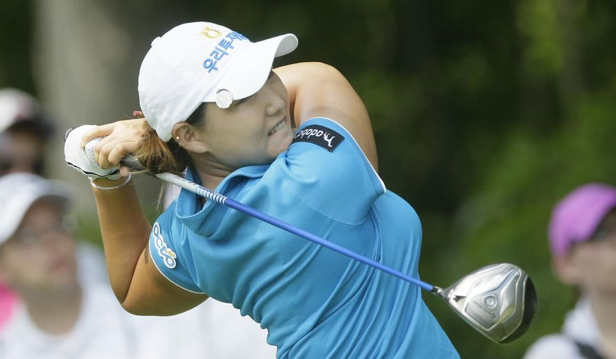 Mirim Lee of South Korea drives on the seventh hole during the final round of the Meijer LPGA Classic golf tournament at Blythefield Country Club, Sunday, Aug. 10, 2014, in Belmont, Mich. (AP Photo/Carlos Osorio)