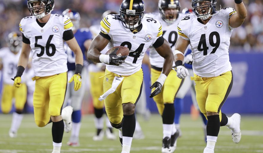 Pittsburgh Steelers linebacker Howard Jones (34) runs back a New York Giants fumble for a touchdown followed by outside linebacker Jordan Zumwalt (56) and running back Jordan Hall (49) in the fourth quarter of a preseason NFL football game, Saturday, Aug. 9, 2014, in East Rutherford, N.J. (AP Photo/Frank Franklin II)