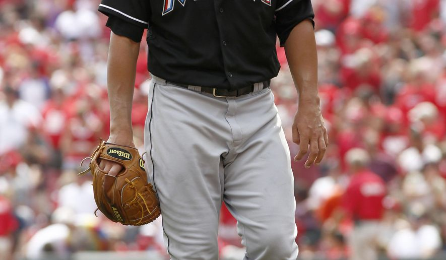 Miami Marlins starting pitcher Brad Hand walks off the field after giving up a grand slam to Cincinnati Reds' Devin Mesoraco in the fifth inning of a baseball game, Sunday, Aug. 10, 2014, in Cincinnati. (AP Photo/David Kohl)