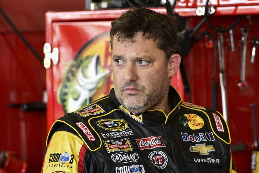 """In this Friday, Aug. 8, 2014 photograph, Tony Stewart stands in the garage area after a practice session for Sunday's NASCAR Sprint Cup Series auto race at Watkins Glen International, in Watkins Glen N.Y.  Stewart struck and killed Kevin Ward Jr., 20, a sprint car driver who had climbed from his car and was on the track trying to confront Stewart during a race at Canandaigua Motorsports Park in upstate New York on Saturday night. Ontario County Sheriff Philip Povero said his department's investigation is not criminal and that Stewart was """"fully cooperative"""" and appeared """"very upset"""" over what had happened. (AP Photo/Derik Hamilton)"""