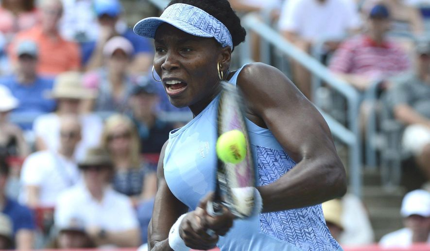 Venus Williams of the United States returns to Agnieszka Radwanska of Poland during the final of the Rogers Cup tennis tournament on Sunday, Aug. 10, 2014, in Montreal. (AP Photo/The Canadian Press, Paul Chiasson)