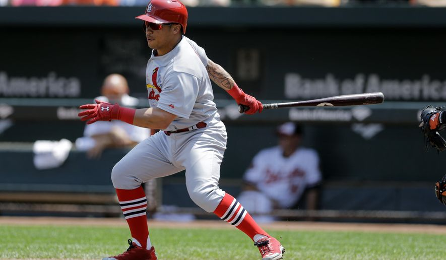St. Louis Cardinals' Kolten Wong singles in the first inning of an interleague baseball game against the Baltimore Orioles, Sunday, Aug. 10, 2014, in Baltimore. (AP Photo/Patrick Semansky)