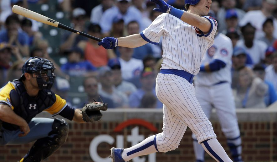 Chicago Cubs' Chris Coghlan, right, hits an one-run triple during the seventh inning of an interleague baseball game against the Tampa Bay Rays in Chicago, Sunday, Aug. 10, 2014. (AP Photo/Nam Y. Huh)