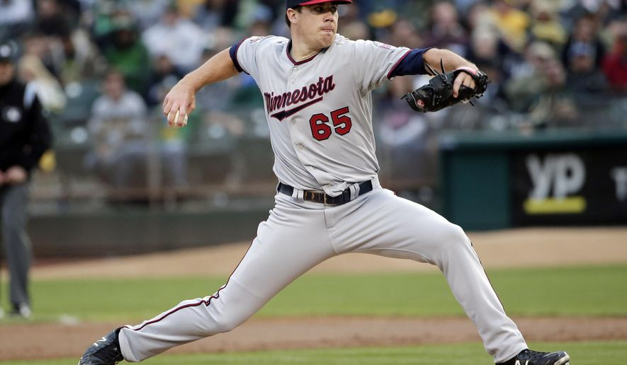 Minnesota Twins starting pitcher Trevor May throws to the Oakland Athletics during the second inning of a baseball game on Saturday, Aug. 9, 2014, in Oakland, Calif. (AP Photo/Marcio Jose Sanchez)