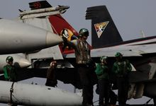 BACK IN IRAQ: Aircraft from the USS George H.W. Bush pounded a range of targets controlled by Islamic State fighters and dropped food and water for tens of thousands of Yazidi ethnic-religious minorities who have been trapped on a mountaintop. (Associated Press photographs)