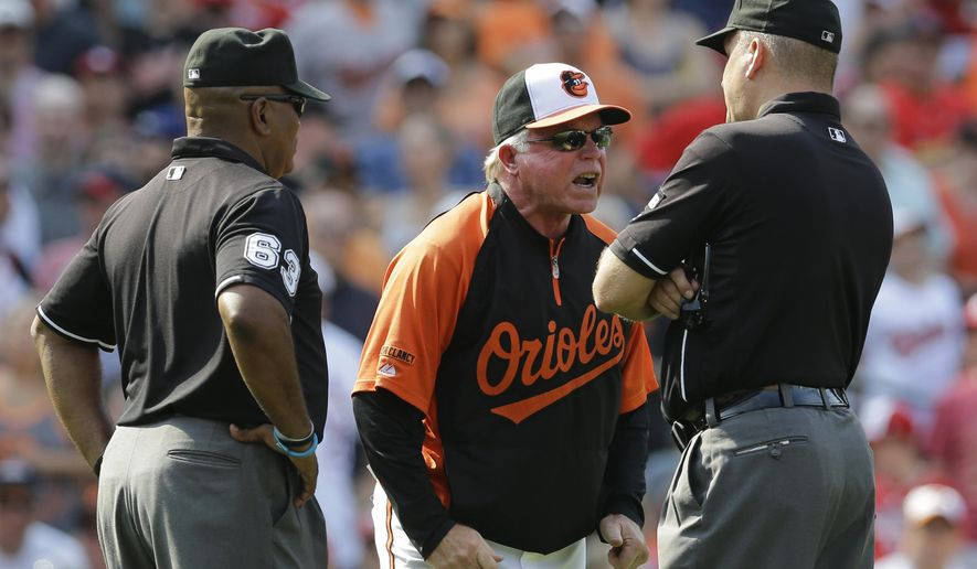 Baltimore Orioles manager Buck Showalter, center, argues a call with third base umpire Laz Diaz, left, and second base umpire Jeff Nelson in the seventh inning of an interleague baseball game against the St. Louis Cardinals, Sunday, Aug. 10, 2014, in Baltimore. Showalter was ejected from the game. St. Louis won 8-3. (AP Photo/Patrick Semansky)