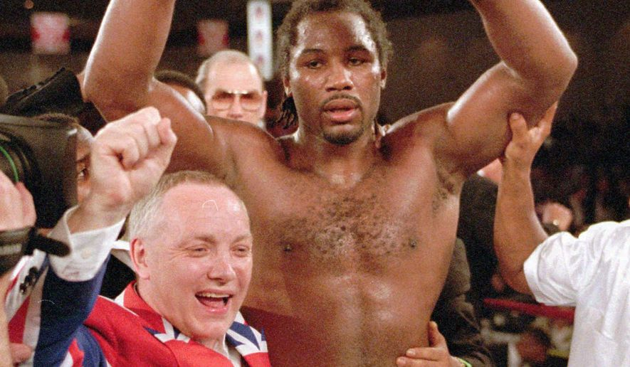 FILE - This is a Friday night, Feb. 7, 1997, file photo of  WBC heavyweight champion Lennox Lewis, right, and his promoter Frank Maloney, as they celebrate his victory over Oliver McCall at the Hilton Hotel in Las Vegas. Lewis captured the title with a fifth round TKO of McCall. LONDON (AP)  Former boxing promoter Frank Maloney says he is undergoing a sex change. The 61-year-old Maloney, who guided Lennox Lewis to the world heavyweight title in the 1990s, told Britain's Sunday Mirror newspaper published on Sunday Aug. 10, 2014, that he is now living as a woman under the name Kellie. (AP Photo/Jeff Scheid, File)