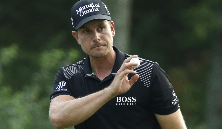 Henrik Stenson, of Sweden, reacts after a birdie on the 13th hole during the final round of the PGA Championship golf tournament at Valhalla Golf Club on Sunday, Aug. 10, 2014, in Louisville, Ky. (AP Photo/John Locher)
