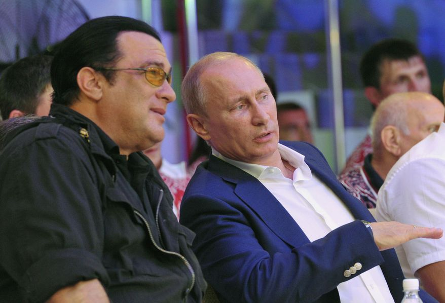 FILE - This is a Saturday, Aug. 11, 2012, file photo  Russian President Vladimir Putin, and U.S. actor Steven Seagal, left, as they watch the first Russian national championship of mixed martial arts in the Black Sea resort of Sochi, southern Russia. The Russian news RIA Novosti says American actor Steven Seagal has performed at a concert in the breakaway region of Crimea on a stage decorated with the flag of pro-Russian separatists fighting in eastern Ukraine. Seagal, who knows Russian President Vladimir Putin, performed Saturday Aug. 9, 2014 in the Black Sea port city of Sevastopol at a concert organized by a motorcycle gang of Russian nationalists known as the Night Wolves. Russia annexed the Ukrainian region in March.(AP Photo/RIA-Novosti,  Alexei Nikolsky, Presidential Press Service, File)