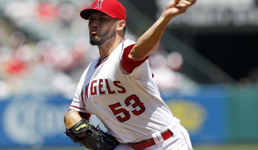 Los Angeles Angels starting pitcher Hector Santiago (53) throws against the Boston Red Sox in the first inning of a baseball game on Sunday, Aug. 10, 2014, in Anaheim, Calif. (AP Photo/Alex Gallardo)