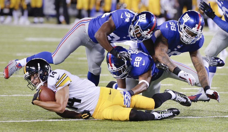 Pittsburgh Steelers wide receiver Derek Moye (14) is tackled by New York Giants cornerback Jayron Hosley (28), strong safety Nat Berhe (34) and defensive end Damontre Moore (98) in the third quarter of a preseason NFL football game, Saturday, Aug. 9, 2014, in East Rutherford, N.J. (AP Photo/Peter Morgan)