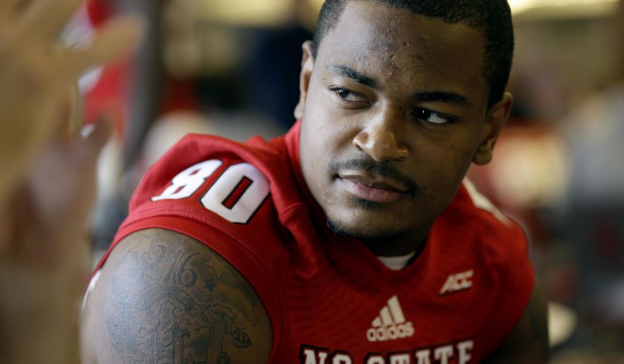 North Carolina State wide receiver Bryan Underwood speaks with reporters during an NCAA football media day in Raleigh, N.C., Sunday, Aug. 10, 2014. (AP Photo/Gerry Broome)