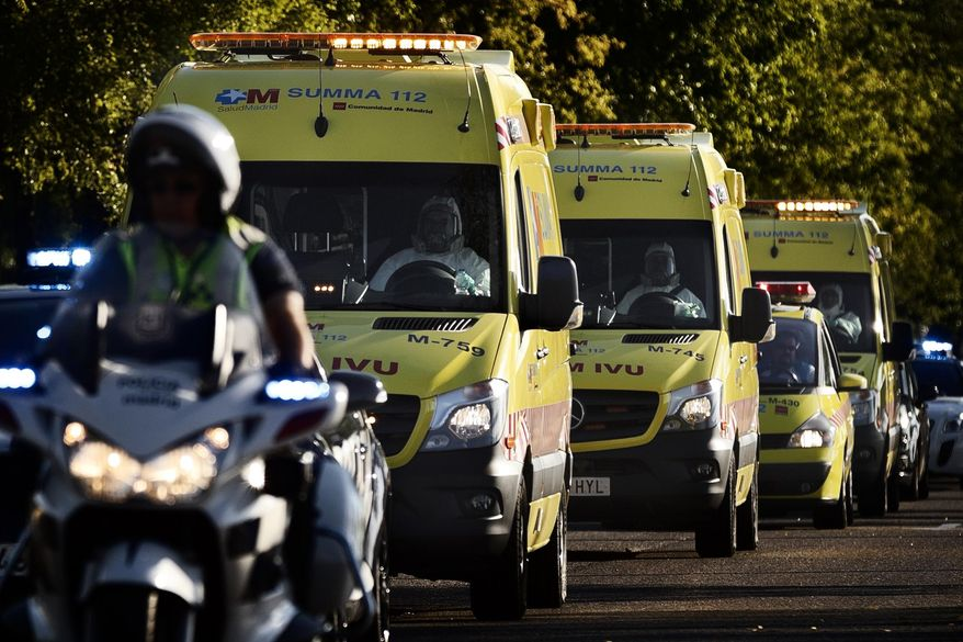 An ambulance transporting Miguel Pajares, a Spanish priest who was infected with the Ebola virus while working in Liberia, leaves the Military Air Base of Torrejon de Ardoz, near Madrid, Spain. Mr. Pajares, confirmed as the first Spaniard to be infected by the current outbreak of the ebola virus, is one of the 1,711 reported cases to have been confirmed since March, when the most deadly wave of the condition began.  (AP Photo/Daniel Ochoa de Olza)
