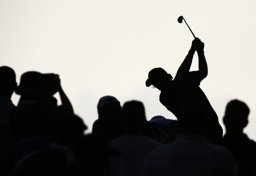 Phil Mickelson hits his tee shot on the 12th hole during the final round of the PGA Championship golf tournament at Valhalla Golf Club on Sunday, Aug. 10, 2014, in Louisville, Ky. (AP Photo/David J. Phillip)