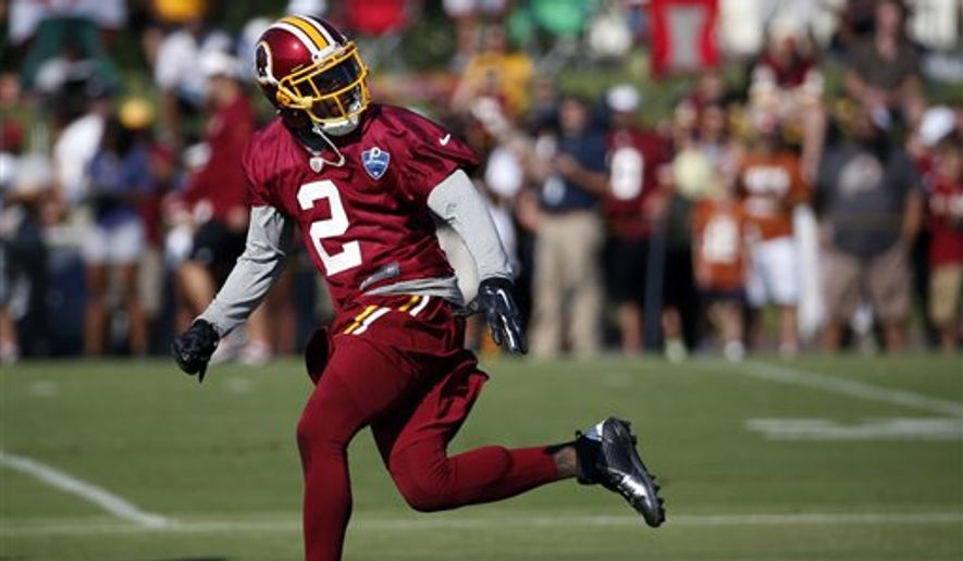 Washington Redskins cornerback DeAngelo Hall runs a drill during practice at the team's NFL football training facility, Friday, July 25, 2014 in Richmond, Va. (AP Photo)