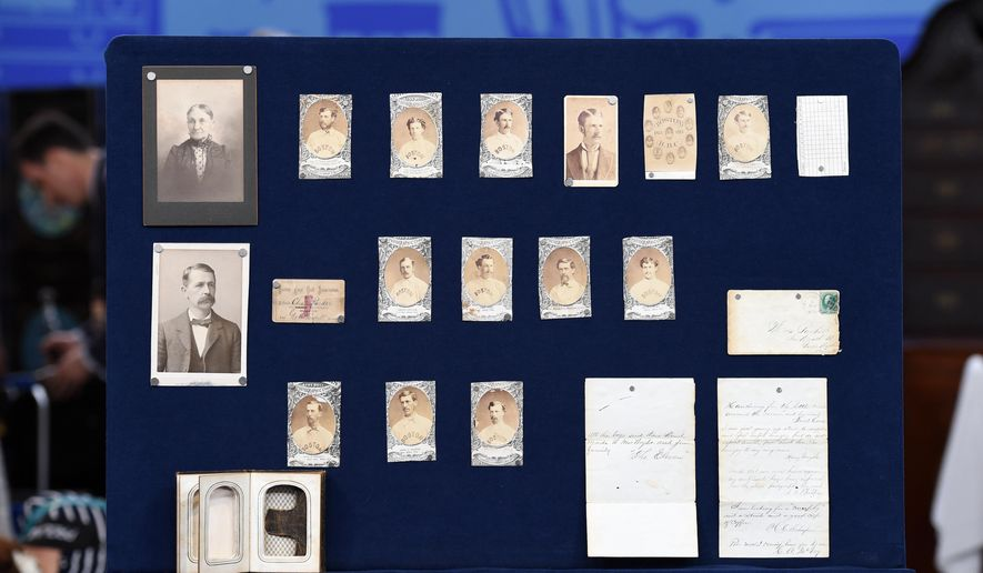 """This Aug. 9, 2014 photo released by Antiques Roadshow shows a collection of early Boston baseball memorabilia for the program """"Antiques Roadshow"""" in New York. This is the largest sports memorabilia find in the program's 19-year history, valued at $1 million. (AP Photo/Leila Dunbar, Meredith Nierman)"""