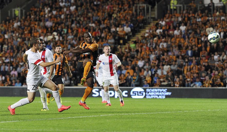 Hull City's Sone Aluko scores against AS Trencin during their Europa League qualifying, third round, second leg soccer match at the KC Stadium, Hull, England, Thursday Aug. 7, 2014. (AP Photo/PA, Anna Gowthorpe) UNITED KINGDOM OUT  NO SALES  NO ARCHIVE