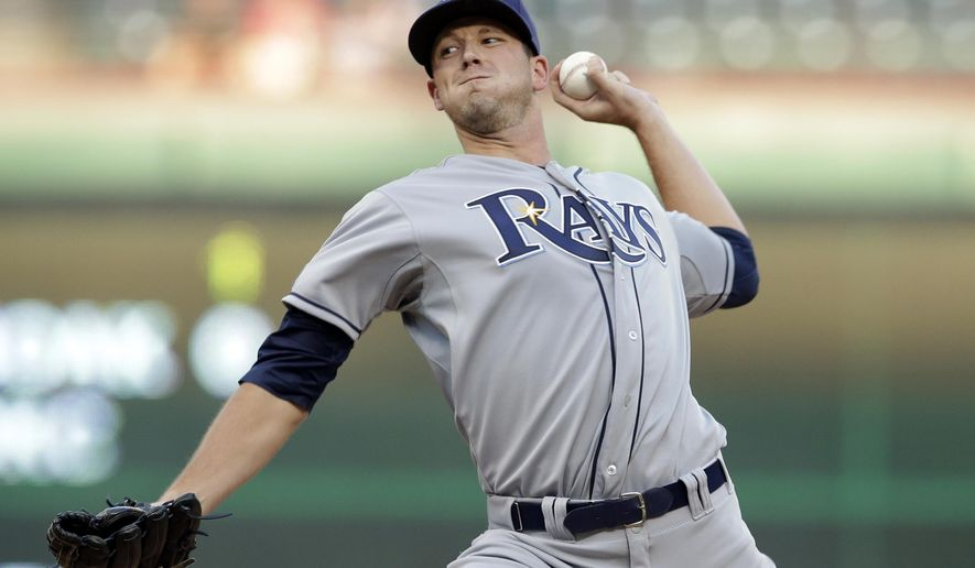 Tampa Bay Rays starting pitcher Drew Smyly works against the Texas Rangers in the first inning of a baseball game, Monday, Aug. 11, 2014, in Arlington, Texas. (AP Photo/Tony Gutierrez)
