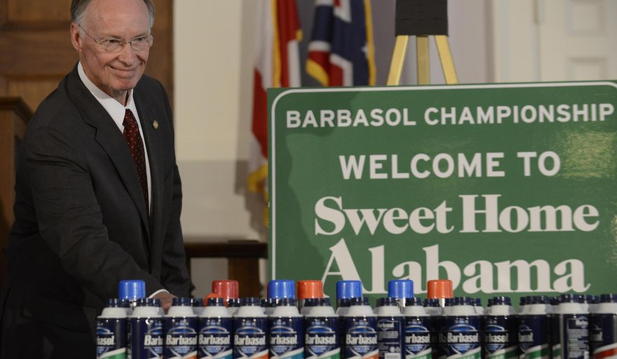 Alabama Gov. Robert Bentley announces that the PGA Barbasol Championship will be held at the Robert Trent Jones Golf Trail Grand National in Opelika, Ala. in 2015 during a news conference at the state capitol building in Montgomery, Ala. on Monday, Aug. 11, 2014. (AP Photo / Montgomery Advertiser, Mickey Welsh)