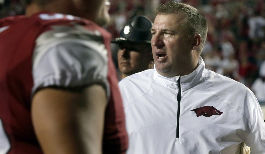 FILE - In this  Sept. 7, 2013, file photo, Arkansas coach Bret Bielema, right, shouts after his team's victory over Samford in an NCAA college football game in Little Rock, Ark. Bielema begins his second season with Arkansas in 2014. (AP Photo/Danny Johnston, File)