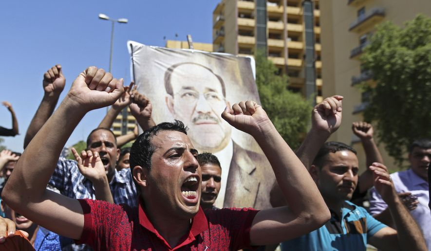 "Iraqis chant pro-government slogans and display placards bearing a picture of embattled Prime Minister Nouri al-Maliki during a demonstration in Baghdad, Iraq, Monday, Aug. 11, 2014. Al-Maliki is taking his struggle to keep his job to the courts after announcing he will file a legal complaint on Monday against the country's newly elected president. President Barack Obama warned Americans on Saturday that the new campaign to bring security in Iraq requires military and political changes and ""is going to be a long-term project."" (AP Photo/ Hadi Mizban)"