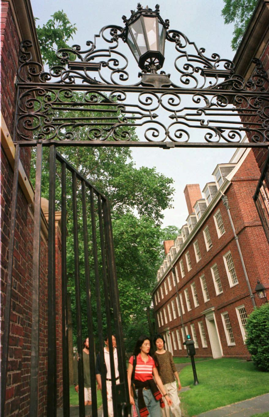 Passersby exit an entrance to the main campus of Harvard University in Cambridge, Mass., Sunday, May 31, 1998. The university's endowment of nearly $13 billion makes it the richest in the world and, if ranked against Fortune 500 companies it would be in the top 25 percent, The Boston Globe reported Sunday. (AP Photo/Patricia McDonnell)