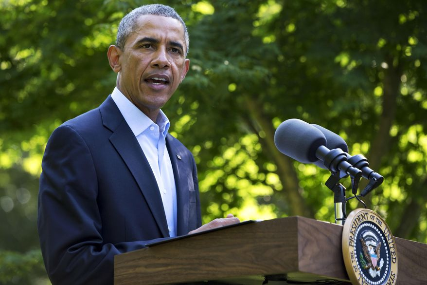 ** FILE ** President Obama speaks to the press from Chilmark, Mass., during his family vacation on the island of Martha's Vineyard, Aug. 11, 2014. (AP Photo/Jacquelyn Martin)