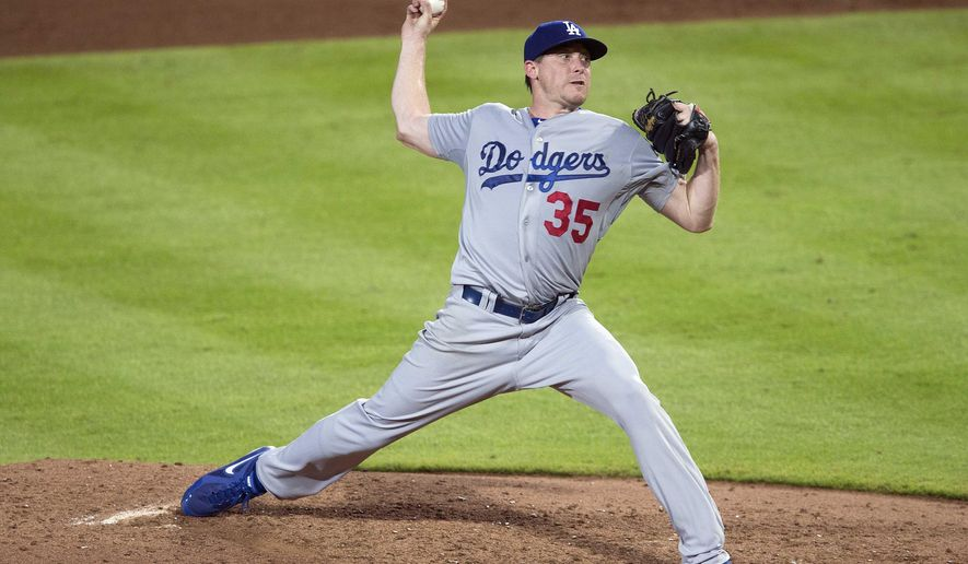 Los Angeles Dodgers pitcher Kevin Correia works in the sixth inning of a baseball game against the Atlanta Braves  Monday, Aug. 11, 2014 in Atlanta.  (AP Photo/John Bazemore)