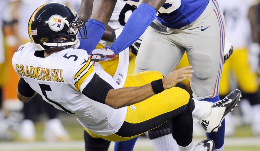 FILE - In this Aug. 9, 2014, file photo, New York Giants defensive end Jason Pierre-Paul (90) pressures Pittsburgh Steelers quarterback Bruce Gradkowski (5) on a throw in the first quarter of a preseason NFL football game in East Rutherford, N.J. Pierre-Paul is starting to show signs that he is over the injuries that limited his effectiveness last season. (AP Photo/Bill Kostroun, File)