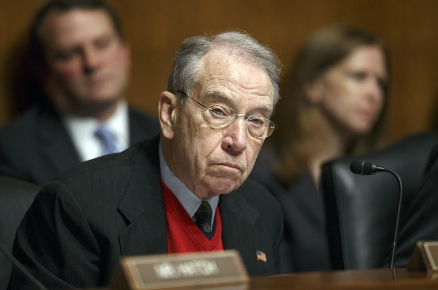 Sen. Chuck Grassley, Iowa Republican and ranking member of the Senate Judiciary Committee, appears at a hearing on Capitol Hill in Washington on Jan. 29, 2014. (Associated Press) **FILE**
