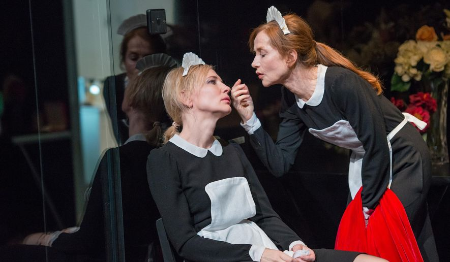 """This image released by Lincoln Center Festival shows Cate Blanchett, left, and Isabelle Huppert, in a scene from the Sydney Theatre Company's production of """"The Maids,""""currently performing at the Lincoln Center Festival in New York. (AP Photo/Lincoln Center Festival, Stephanie Berger)"""