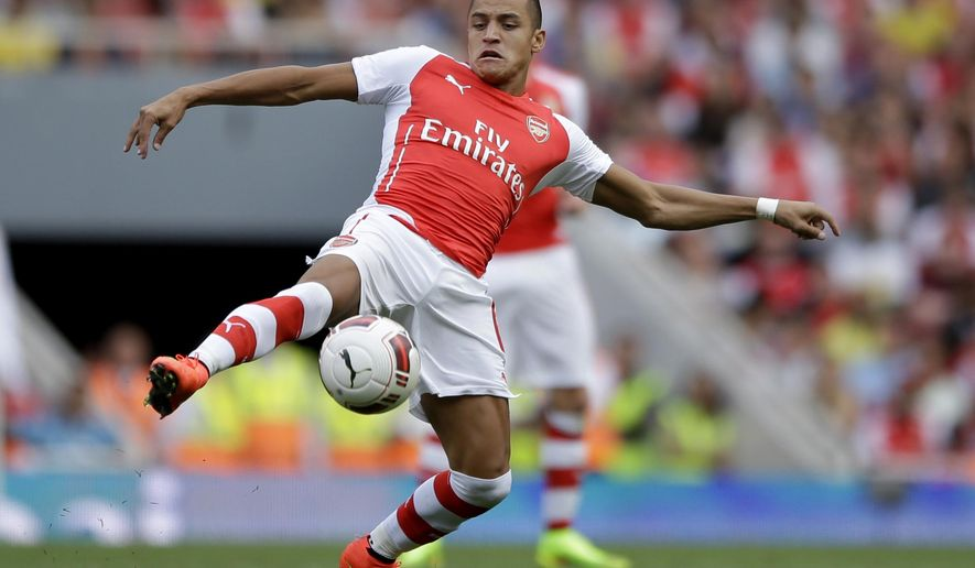 FILE - This is a Saturday, Aug. 2, 2014 file photo of Arsenal's Alexis Sanchez, new signing as he controls the ball during the Emirates Cup soccer match between between Arsenal and Benfica at Arsenal's Emirates Stadium in London. The new English Premier League season starts on Saturday Aug. 16, 2014. (AP Photo/Matt Dunham, File)