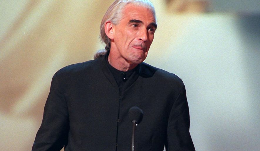 "FILE - This May 22, 1996 file photo shows actor Charles Keating posing with his award for outstanding lead actor in a drama series for his role in ""Another World,"" during the 23rd Annual Daytime Emmy Awards in New York. Keating, 72, died Friday, Aug. 8, in Connecticut after a three-year battle with lung cancer, according to his son, Sean. (AP Photo/Joe Tabacca, File)"