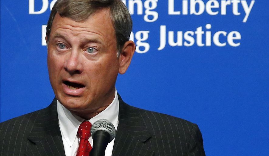 """Supreme Court Chief Justice John Roberts speaks at the American Bar Association's annual meeting in Boston, Monday, Aug. 11, 2014. Roberts, who has served as chief justice since 2005, talked about the """"historical and present-day significance"""" of the Magna Carta. The document laid the groundwork for representative democracy and the rule of law upon its signing in England in 1215. (AP Photo/Elise Amendola)"""