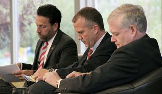 From left, U.S. Senate Republican candidates Joe Miller, Dan Sullivan and Lt. Gov. Mead Treadwell prepare for a debate in Eagle River, Alaska, Monday, Aug. 4, 2014. The winner of the Aug. 19 primary will advance to the general election and likely face U.S. Sen. Mark Begich, D-Alaska, who faces token opposition in the Democratic primary. (AP Photo/Mark Thiessen)
