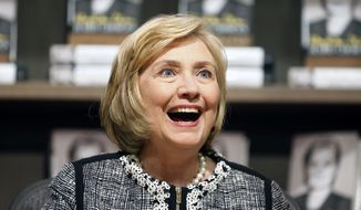 "** FILE ** This July 29, 2014, file photo shows former Secretary of State Hillary Rodham Clinton as she greets a customer during a book signing of her new book ""Hard Choices"" at Northshire Bookstore in Saratoga Springs, N.Y. (AP Photo/Mike Groll, File)"
