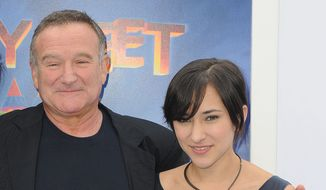 "FILE - This Nov. 13, 2011 file photo shows actor Robin Williams, left, and his daughter, Zelda at the premiere of  ""Happy Feet Two"" in Los Angeles. Williams, whose free-form comedy and adept impressions dazzled audiences for decades, has died in an apparent suicide. He was 63. The Marin County Sheriff's Office said Williams was pronounced dead at his home in California on Monday, Aug. 11, 2014. The sheriff's office said a preliminary investigation showed the cause of death to be a suicide due to asphyxia. (AP Photo/Katy Winn, File)"