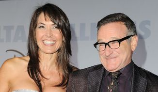 "FILE - This Nov. 9, 2009 file photo shows actor Robin Williams, right, and  his wife Susan Schneider at the premiere of ""Old Dogs"" in Los Angeles. Williams, whose free-form comedy and adept impressions dazzled audiences for decades, died Monday, Aug. 11, 2014, in an apparent suicide. Williams was 63. (AP Photo/Katy Winn, FIle)"
