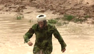Investigative filmmaker James O'Keefe donned an Osama bin Laden mask and sneaked across the Rio Grande in his new media stunt meant to expose the vulnerabilities of the U.S.-Mexico border. (YouTube)